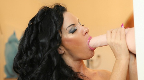 hot-brunette-sucking-her-toy